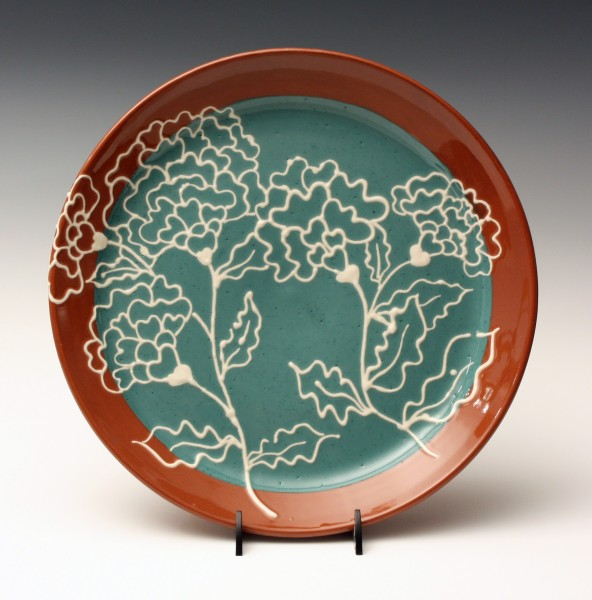 Teal with white slip trailed flowers plate 10 3/4