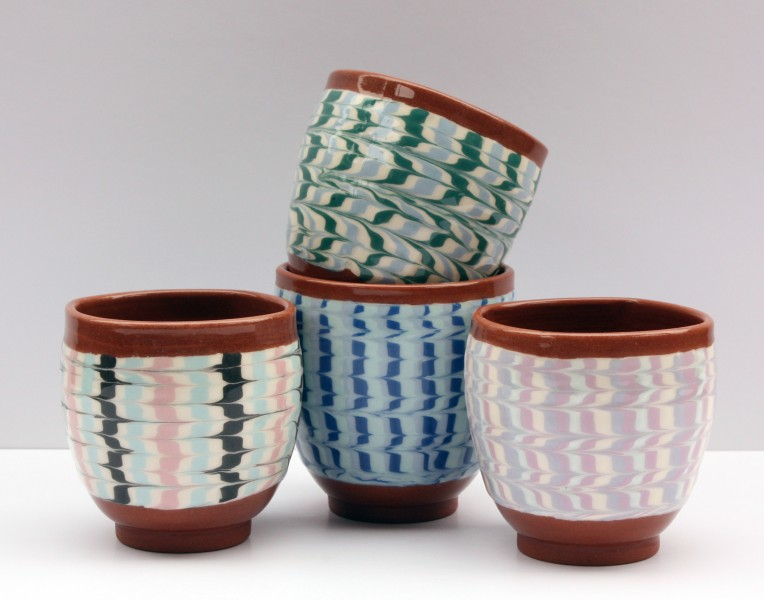Feathered slip cups